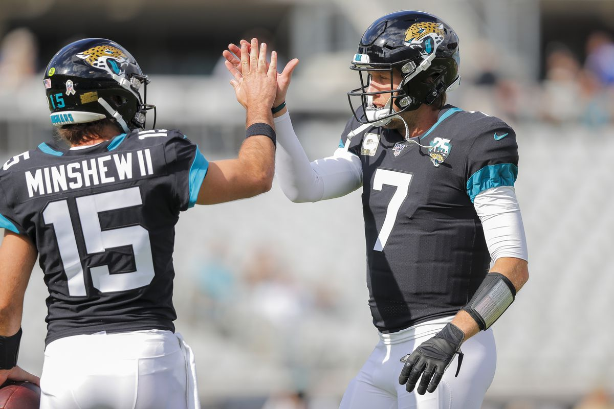 Gardner Minshew of the Jacksonville Jaguars and Nick Foles warm up before the start of a game against the Tampa Bay Buccaneers at TIAA Bank Field on December 01, 2019 in Jacksonville, Florida.