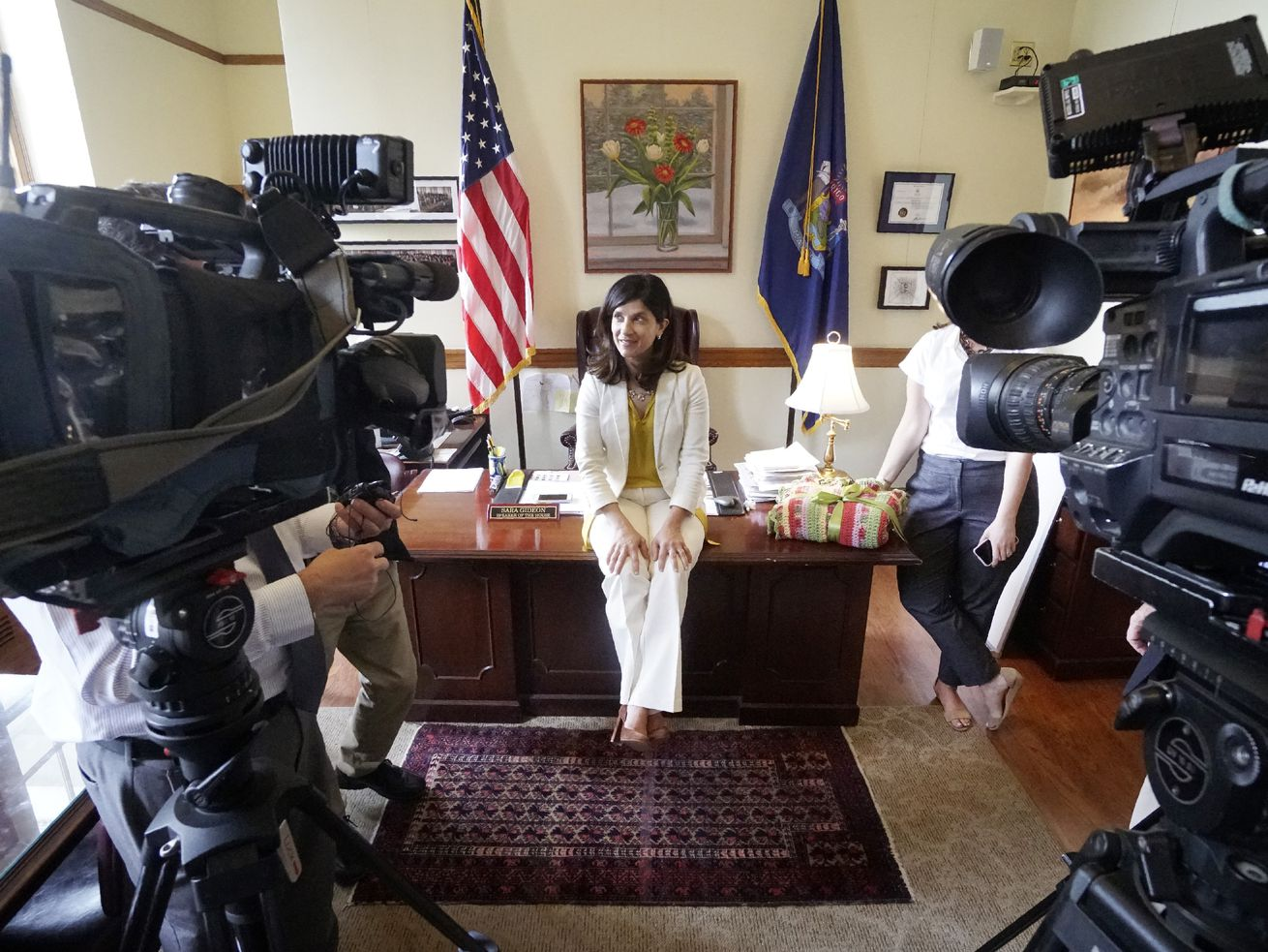 Maine House Speaker Sara Gideon talks with the media