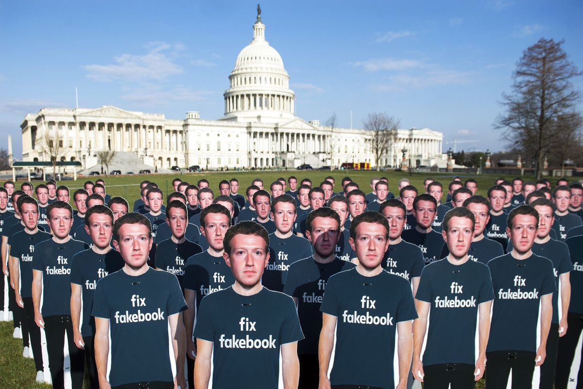 One hundred cardboard cutouts of Facebook founder and CEO Mark Zuckerberg are displayed outside the US Capitol in 2018.