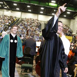 Former presidential candidate and Massachusetts Gov. Mitt Romney waves to graduates at Utah Valley University during commencement in Orem on Thursday, April 30, 2015.