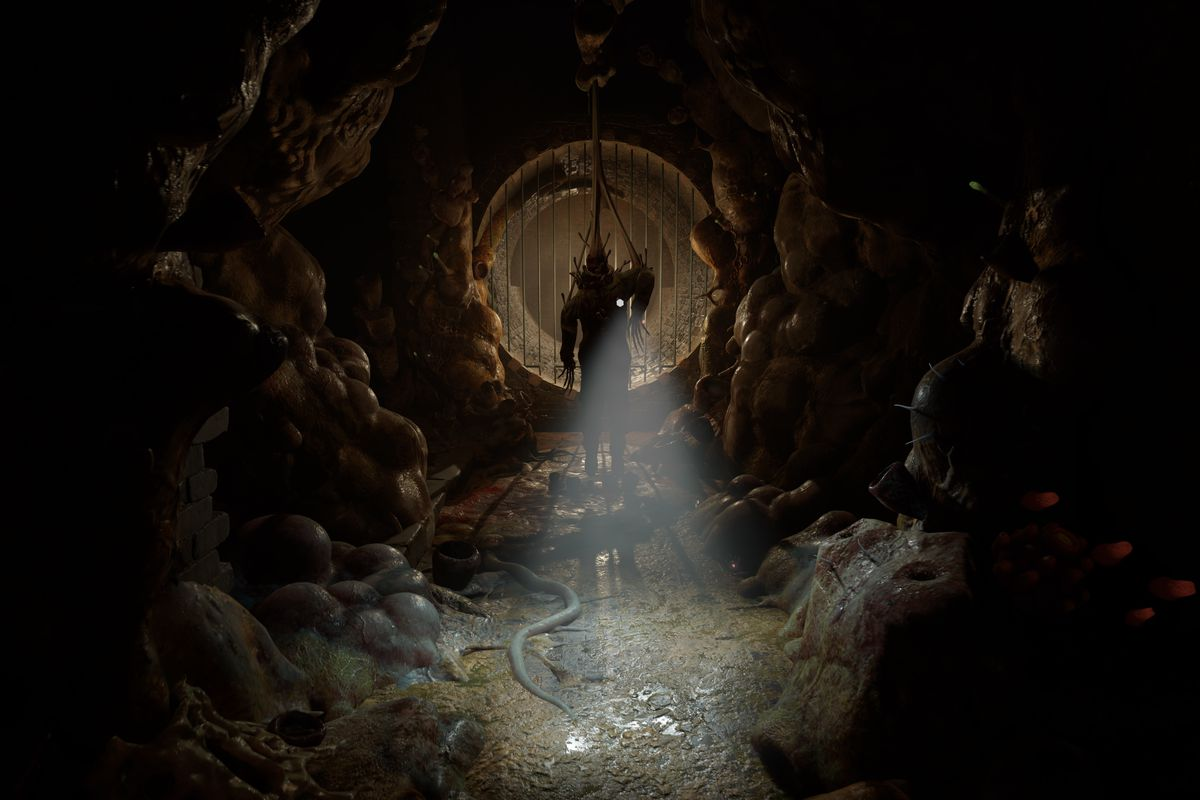 An infected body hangs from the ceiling in a sewer in a screenshot from Half-Life: Alyx.