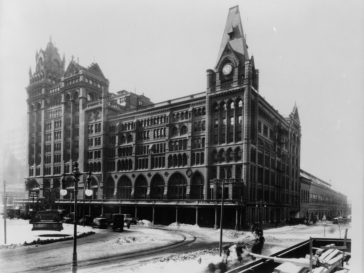 The exterior of a building by Frank Furness in Philadelphia. This is an old black and white photograph.