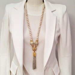"""""""All too soon, the temperatures will be soaring and nothing keeps you cooler than all white! It is chic. It is effortless. It is a must for keeping your cool this summer! This blazer is by Yonana Baraschi ($350) and the mesh top is from Giada Forte ($405)"""