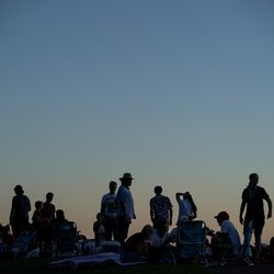 People gather at Rock Canyon Park in Provo to watch fireworks on Saturday, July 4, 2020.