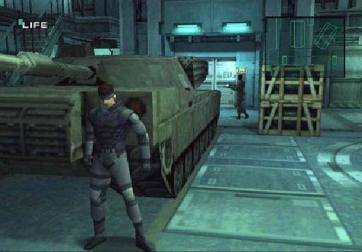 Metal Gear Solid - Snake hiding behind a tank at Shadow Moses facility