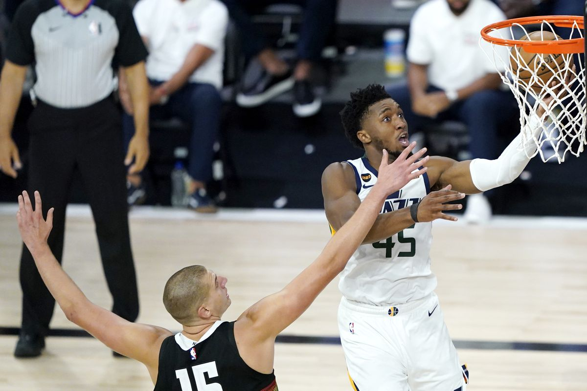 Donovan Mitchell of the Utah Jazz goes up for a shot against Nikola Jokic of the Denver Nuggets during the second half of an NBA basketball first-round playoff game at The Field House at ESPN Wide World Of Sports Complex on August 17, 2020 in Lake Buena Vista, Florida.
