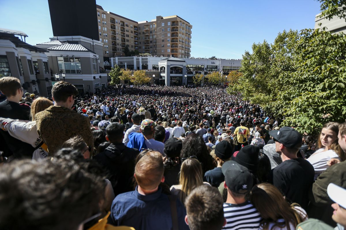 """Several thousand people pack into The Gateway mall in Salt Lake City for Kanye West's """"Sunday Service"""" on Saturday, Oct. 5, 2019. People were standing on and climbing up anything they could find to catch a glimpse of West."""