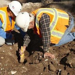 BYU archaeologists excavating the Provo baptismal font use many different types of tools, from a bulldozer to brushes and dental picks.