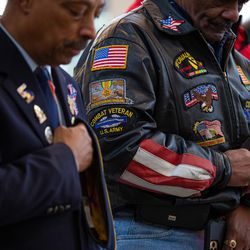 Veterans during the invocation on Veterans Day Monday, Nov. 11, 2019.