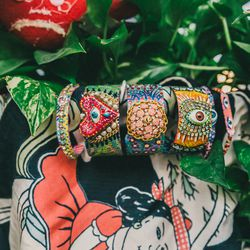 """'You Know Too' bangle, $160; 'Virgen de Guadalupe' cuff, $285; 'Too Much of a Good Thing' cuff, $285; 'Universe' cuff, $285; 'Eye See' bracelet, <a href="""" http://www.susanalexandra.com/products/jgm9jjdhjdl3sihiq7ombmdb1hfhvq"""">$97</a>"""