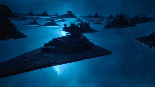 a bolt of lighting illuminates a fleet of star destroyers in a frame from star wars: the rise of skywalker