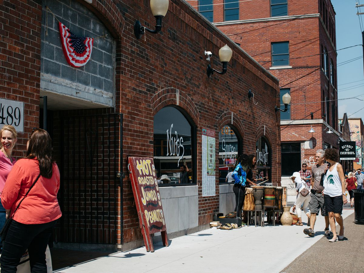 The exterior of the brick building for Rocky's on a sunny Saturday at Eastern Market.