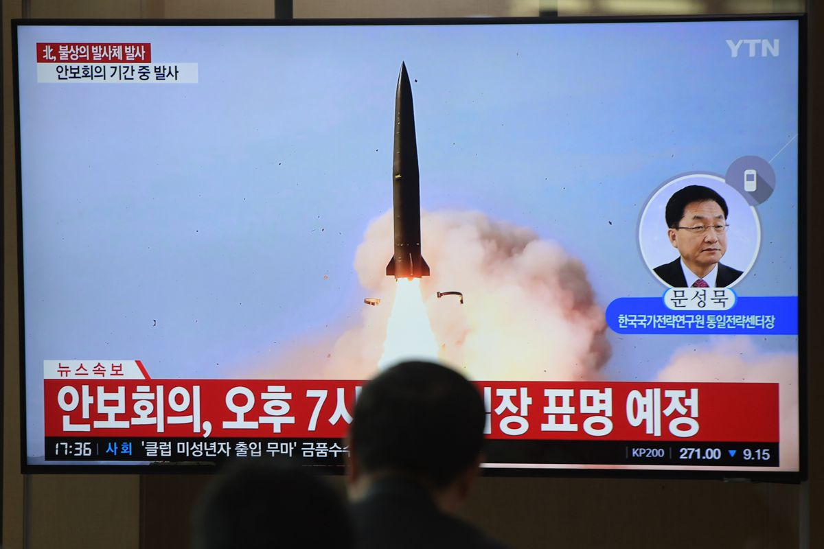 People watch a news program showing footage of North Korea's missile tests at a railway station in Seoul on May 9, 2019.