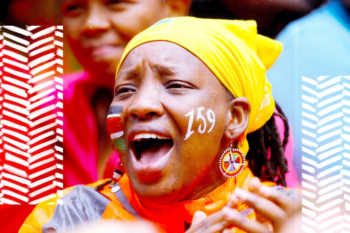 A fan with the Kenyan flag painted on their right cheek reacting while watching Eliud Kipchoge attempt to break the two-hour marathon barrier in Nairobi