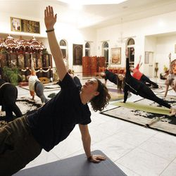 Jeremy Richardson participates in a yoga class at the Hare Krishna Temple in Spanish Fork  Sunday, Nov. 20, 2011.  The class is for people in the community, from troubled teens to pre-missionaries and not just stretching and downward dog, but a chance to renew and find greater connection to God.