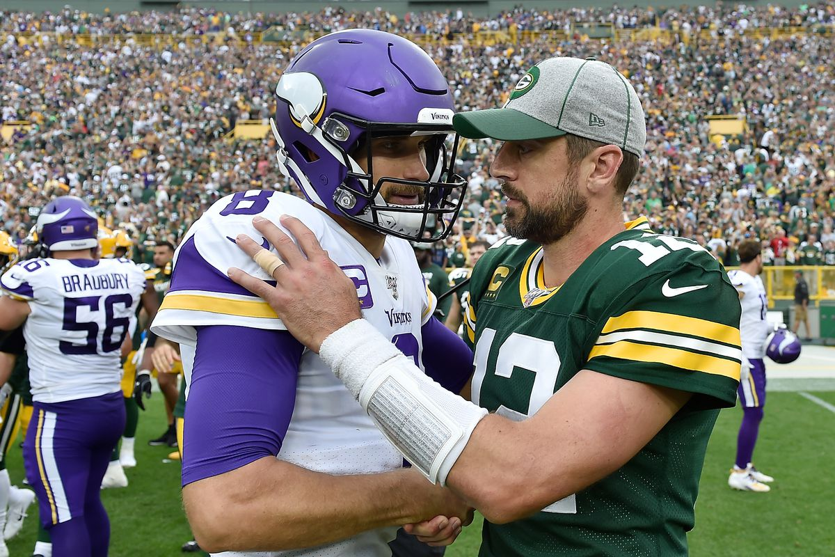 Kirk Cousins of the Minnesota Vikings and Aaron Rodgers of the Green Bay Packers after the game at Lambeau Field on September 15, 2019 in Green Bay, Wisconsin.