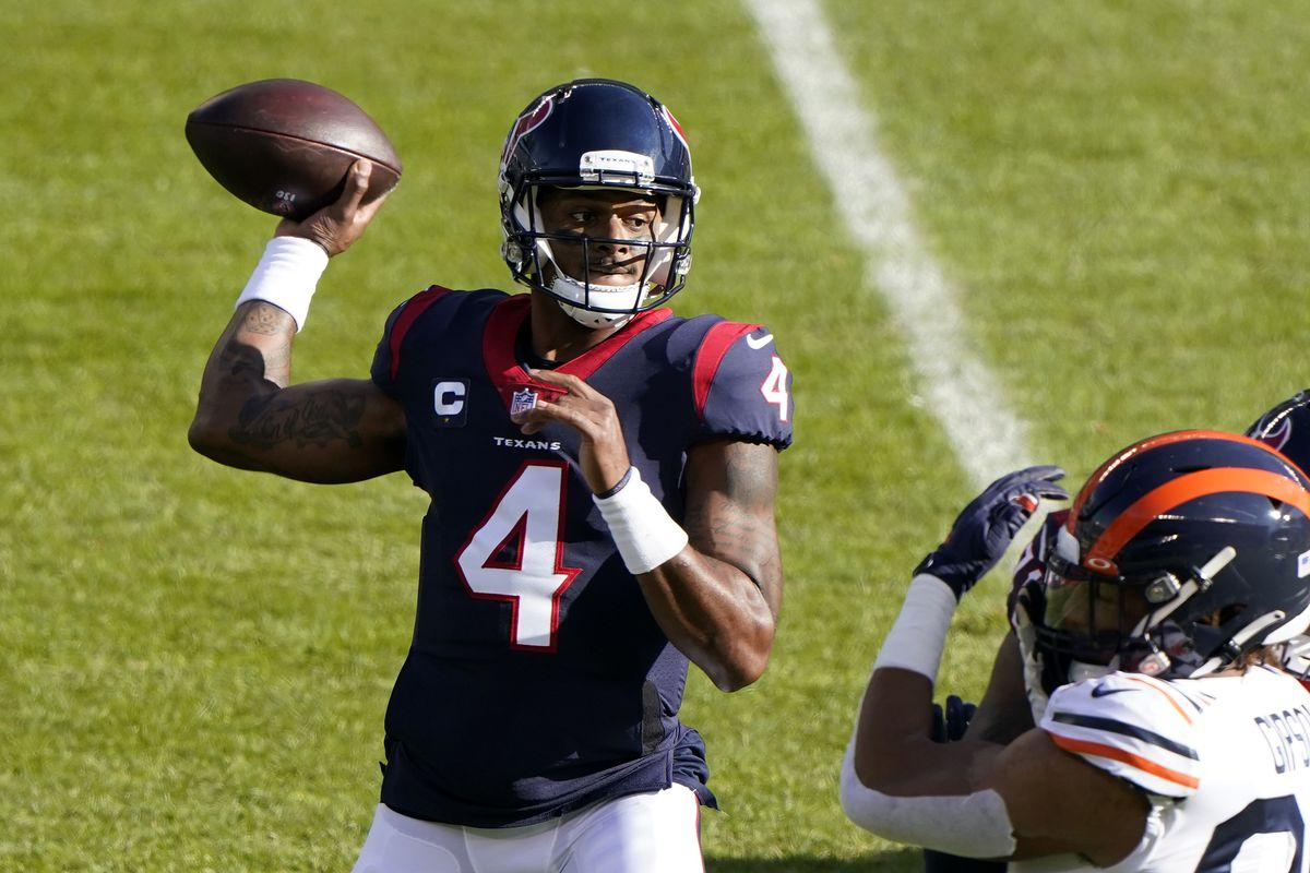 Houston Texans quarterback Deshaun Watson (4) drops back to pass against the Chicago Bears during the first quarter at Soldier Field.