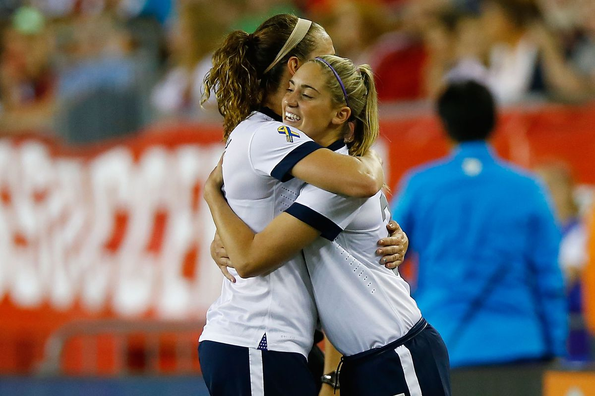 Morgan Brian (right) has plenty of reason to smile after netting a goal for the US last night.