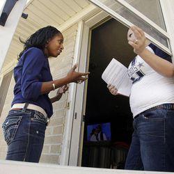 Candidate Mia Love, left, talks with Shelby Snyder-Warenski as she walks door to door in West Valley City on Friday, Nov. 2, 2012.