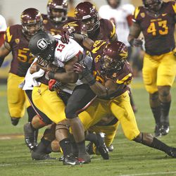 Utah Utes running back Kelvin York (13) is brought down by a group of Arizona State Sun Devils  as the Univeristy of Utah and Arizona State University play PAC 12 football Saturday, Sept. 22, 2012, in Tempe, Arizona.