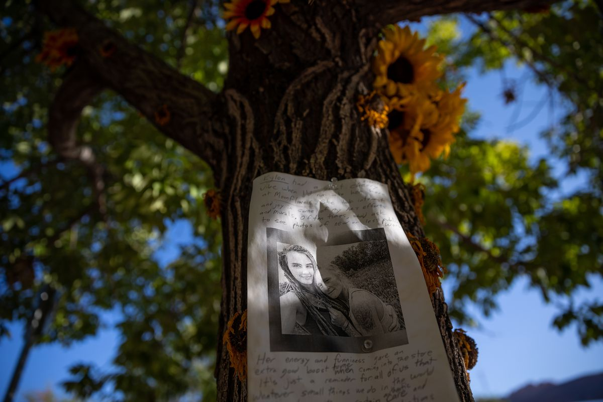 A memorial to Kylen Schulte and Crystal Turner is pictured outside of the Moonflower Community Cooperative, where Schulte used to work, in Moab on Friday, Sept. 17, 2021.