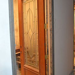 Antique doors add rustic charm to the bathrooms; the glass shown here will be replaced with a smoked wired glass.