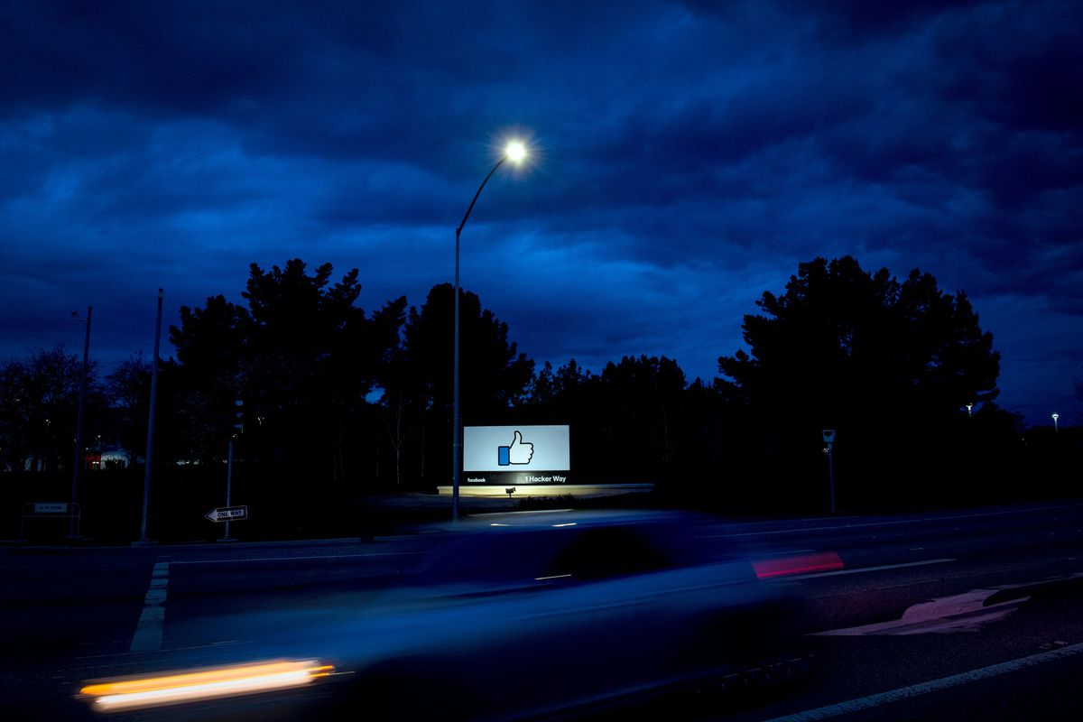 A car passes by Facebook's corporate headquarters in Menlo Park, California, on March 21, 2018.