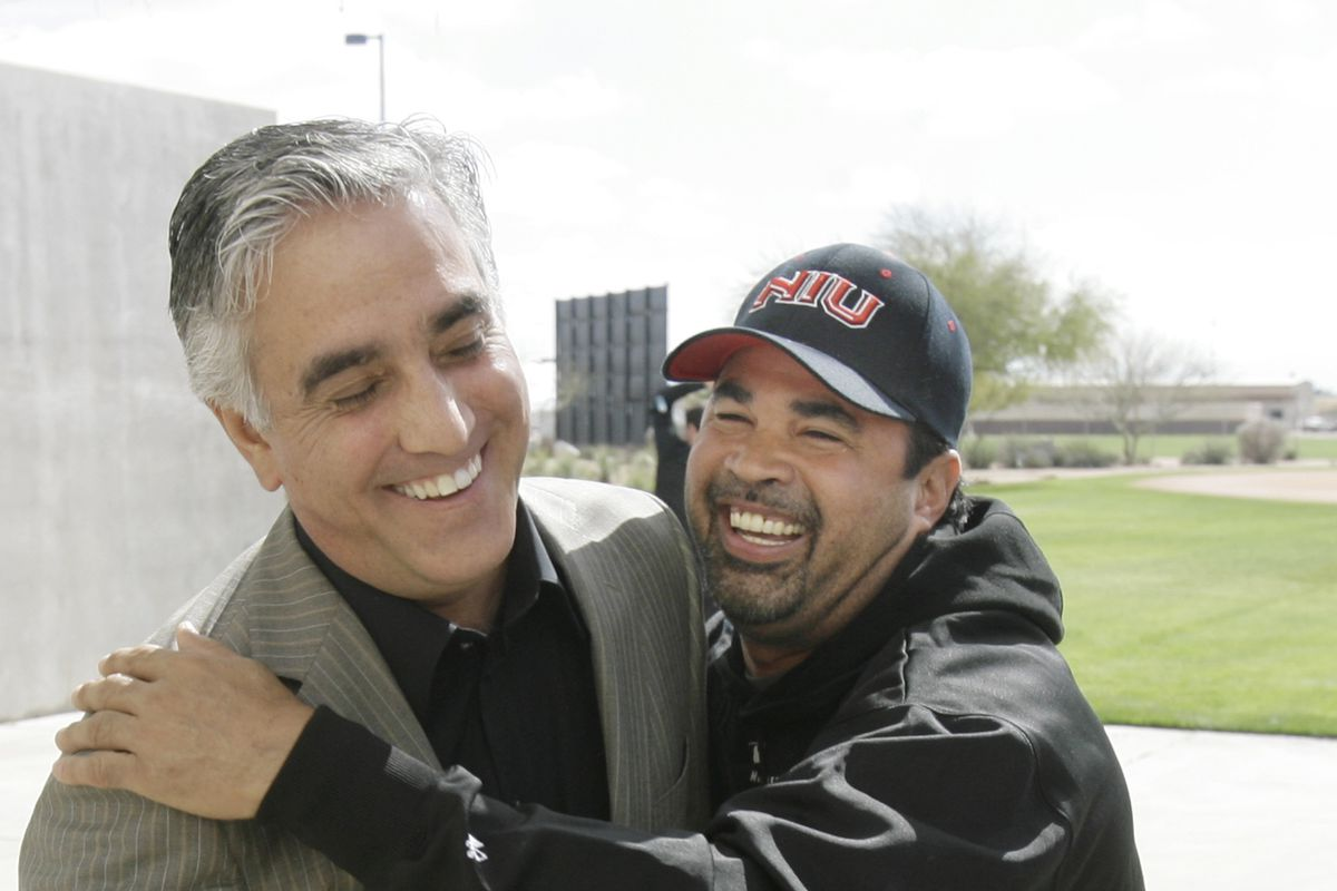 ESPN baseball reporter Pedro Gomez, shown in a 2008 photo with former White Sox manager Ozzie Guillen, died Sunday at age 58.