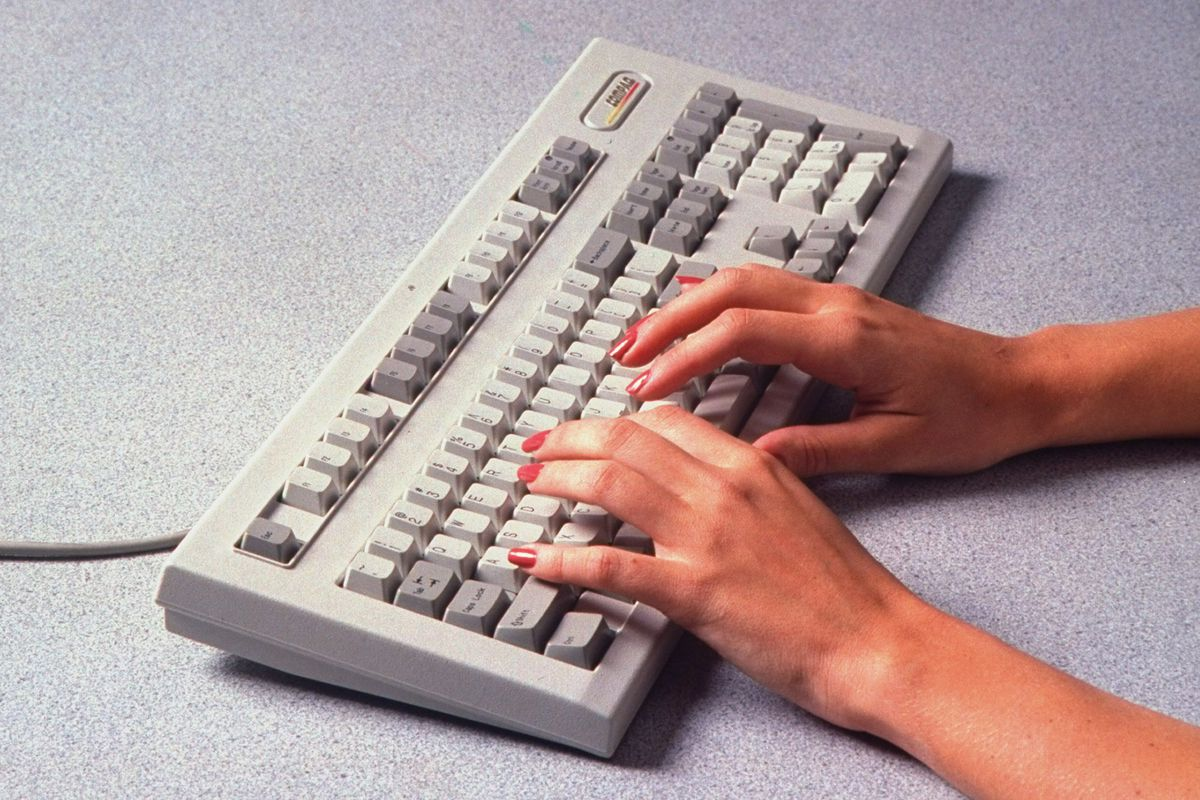 A person types on a mechanical keyboard.