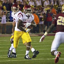 Justin Davis sizes up a defender waiting in the hole.
