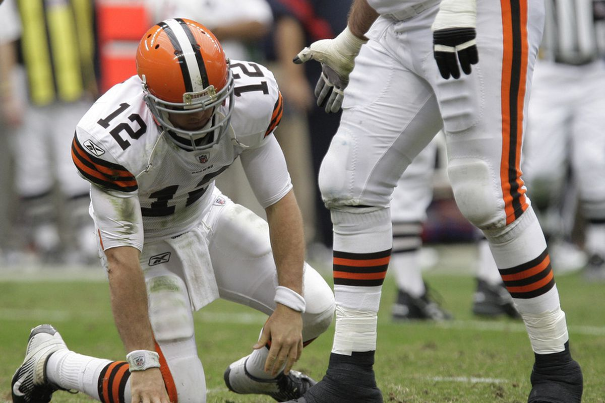 HOUSTON, TX - NOVEMBER 06: Quarterback Colt McCoy #12 of the Cleveland Browns gets up slowly after being sacked against the Houston Texans on November 6, 2011 at Reliant Stadium in Houston, Texas. (Photo by Thomas B. Shea/Getty Images)