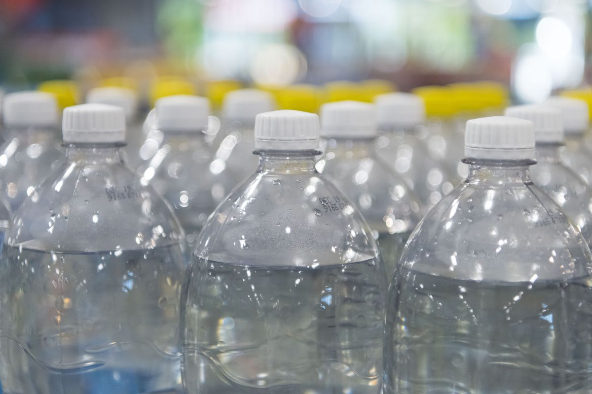 Plastic bottles on sale in a supermarket store.