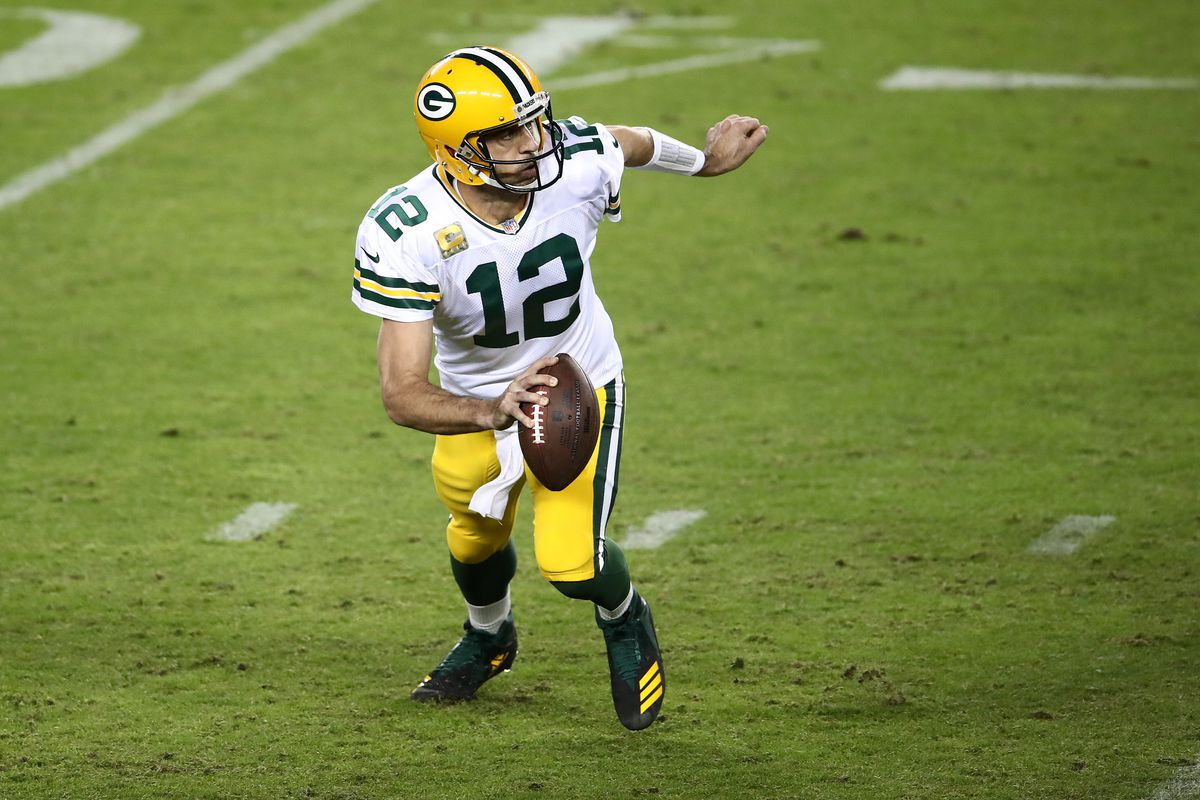 Aaron Rodgers #12 of the Green Bay Packers scrambles against the San Francisco 49ers during the second quarter at Levi's Stadium on November 05, 2020 in Santa Clara, California.