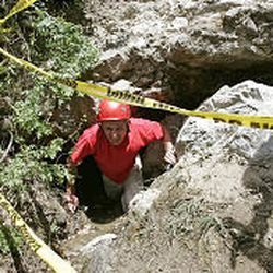 Jared Hubbard of the Provo City Fire Department climbs out of a cave northeast of the Seven Peaks area.