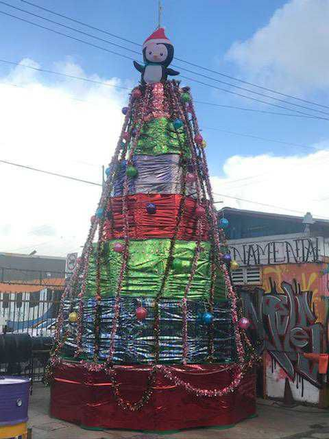 An oil barrel Christmast tree at J & G Ornamental Irons & BBQ Pit Factory in South Los Angeles