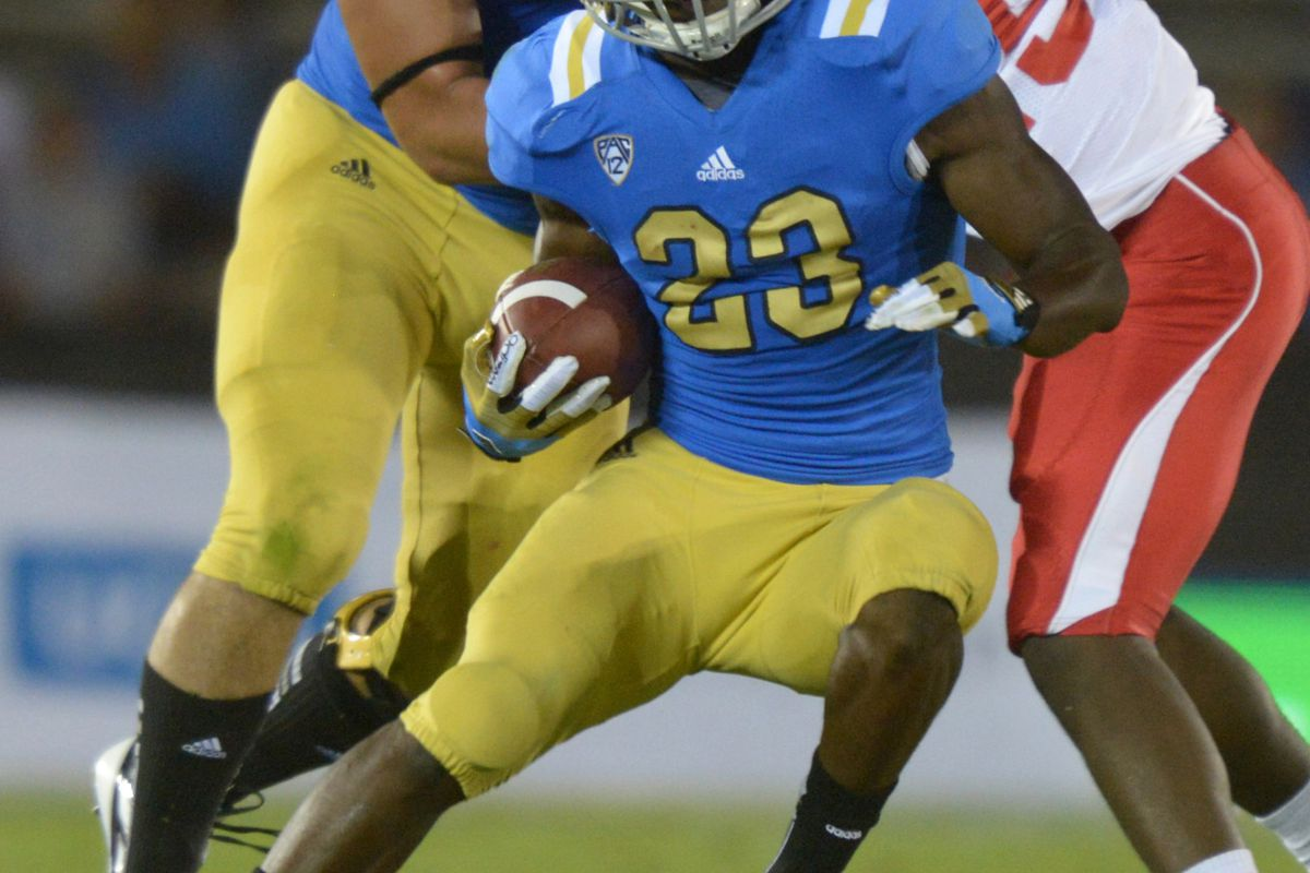 Sep 15, 2012; Los Angeles, CA, USA; UCLA Bruins tailback Johnathan Franklin (23) carries the ball against the Houston Cougars  at the Rose Bowl. Mandatory Credit: Kriby Lee/Image of Sport-US PRESSWIRE