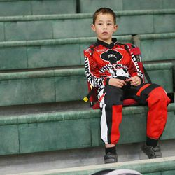 Connor Clifford, 6, relaxes prior to racing BMX in South Jordan on Dec. 6, 2015.
