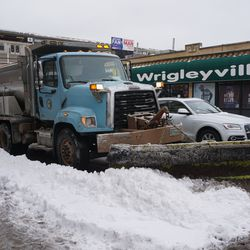 City snowplow heading westbound on Addison, at Sheffield