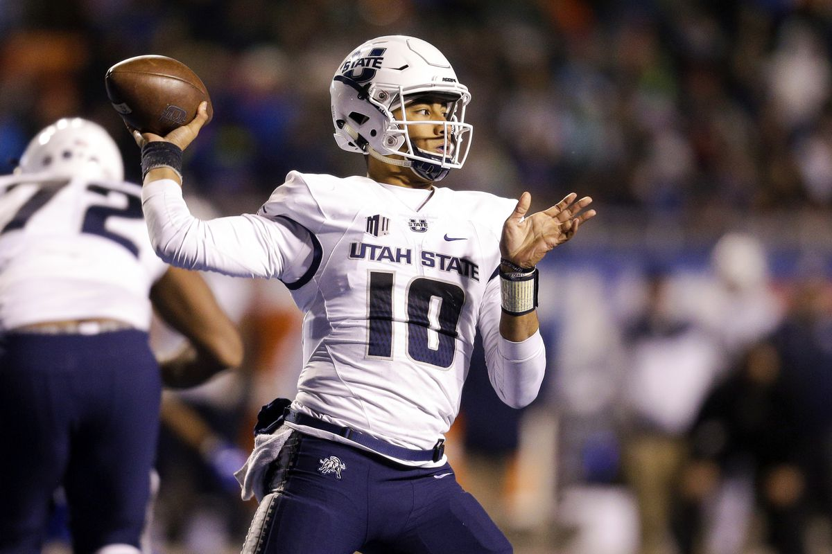 Utah State quarterback Jordan Love (10) looks to throw the ball against Boise State in the second of an NCAA college football game, Saturday, Nov. 24, 2018, in Boise, Idaho. Boise State won 33-24. (AP Photo/Steve Conner)