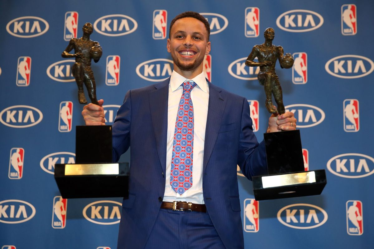 Steph Curry With His Two MVP Trophies Photo By Ezra Shaw Getty Images