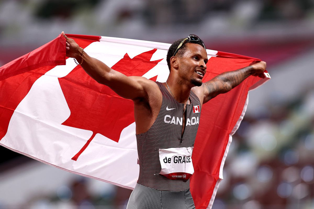 Andre De Grasse of Team Canada celebrates after winning the gold medal in the Men's 200m Final on day twelve of the Tokyo 2020 Olympic Games at Olympic Stadium on August 04, 2021 in Tokyo, Japan.