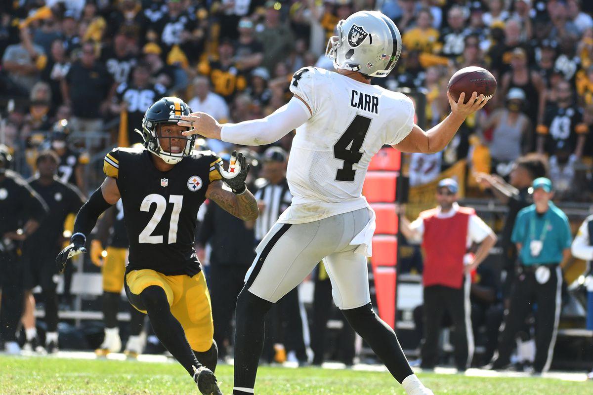 Las Vegas Raiders quarterback Derek Carr throws a 61 yard touchdown as the Pittsburgh Steelers Tre Norwood applies pressure during the fourth quarter at Heinz Field. The Raiders won 26-17.