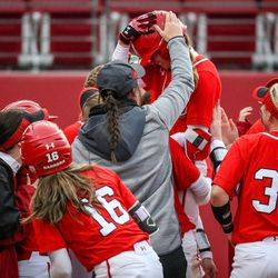 After her solo home run in the bottom of the fifth, Utah infielder Ryley Ball (9) is lifted into the air by her teammates as the University of Utah hosts Brigham Young University at Duke Stadium in Salt Lake City on Wednesday, April 18, 2018.