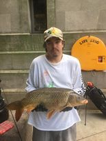 Jeffrey Williams with a Chicago River carp with a story. Provided photo