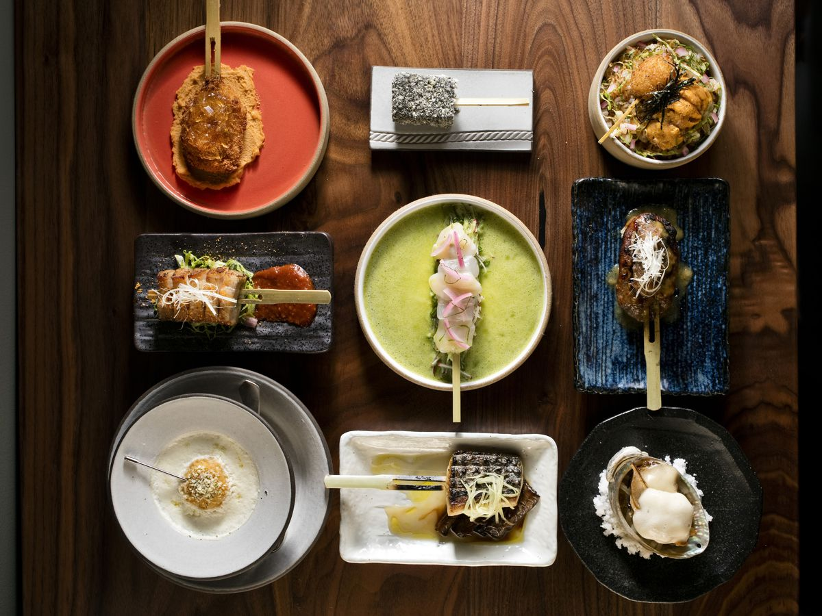 The nine-course menu of various skewers laid out on a table at Kochi