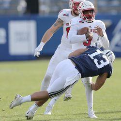 Brigham Young Cougars linebacker Francis Bernard (13) sacks Southern Utah Thunderbirds quarterback Patrick Tyler (3)  in Provo on Saturday, Nov. 12, 2016.