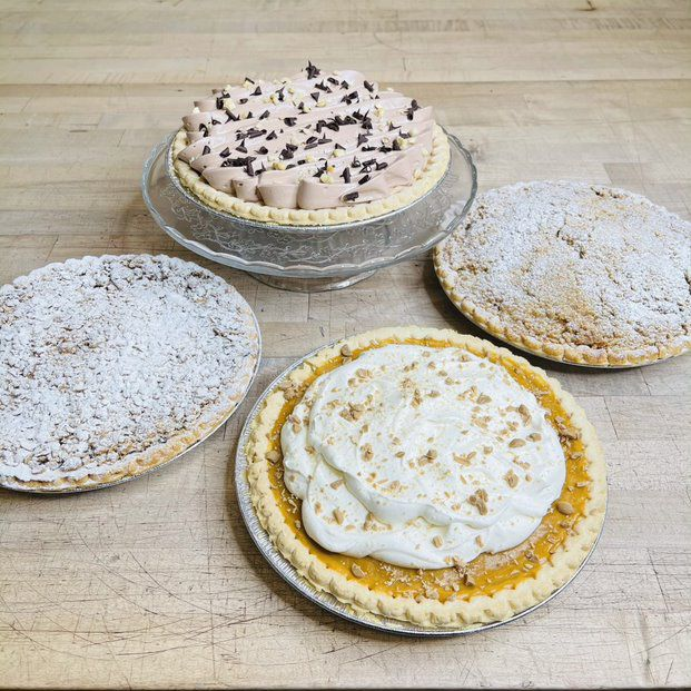 Ten-inch pies —Nutella Silk, Apple Streusel, Butterscotch Cream and Mixed Berry Crumble —are specially priced for National Pi Day at Vanille Patisserie in Lincoln Park.