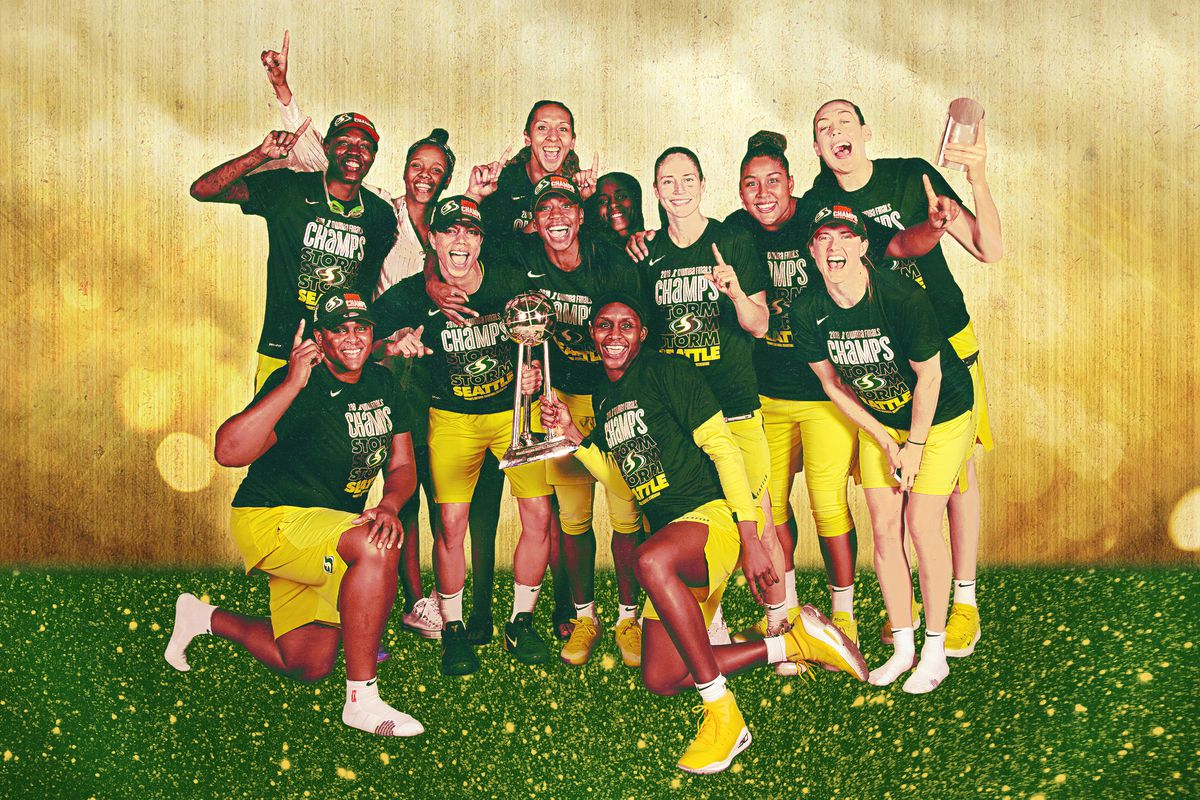 A team photo of the Seattle Storm celebrating after their WNBA Finals win