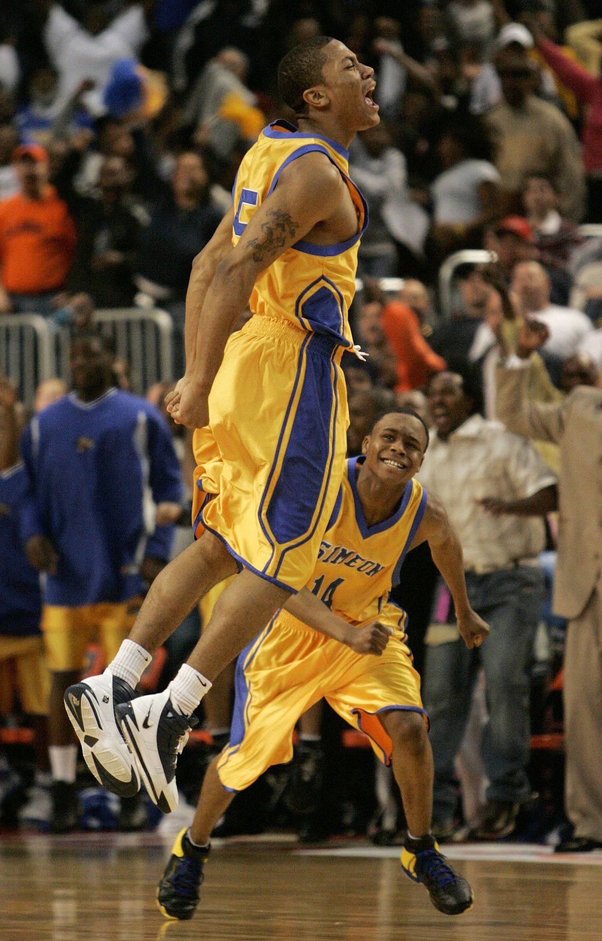 Simeon's Derrick Rose, left, and Randall Hampton celebrate after Rose hit a last-second shot to beat Peoria Richwoods in overtime of the championship game of the IHSA Class AA state basketball tournament.