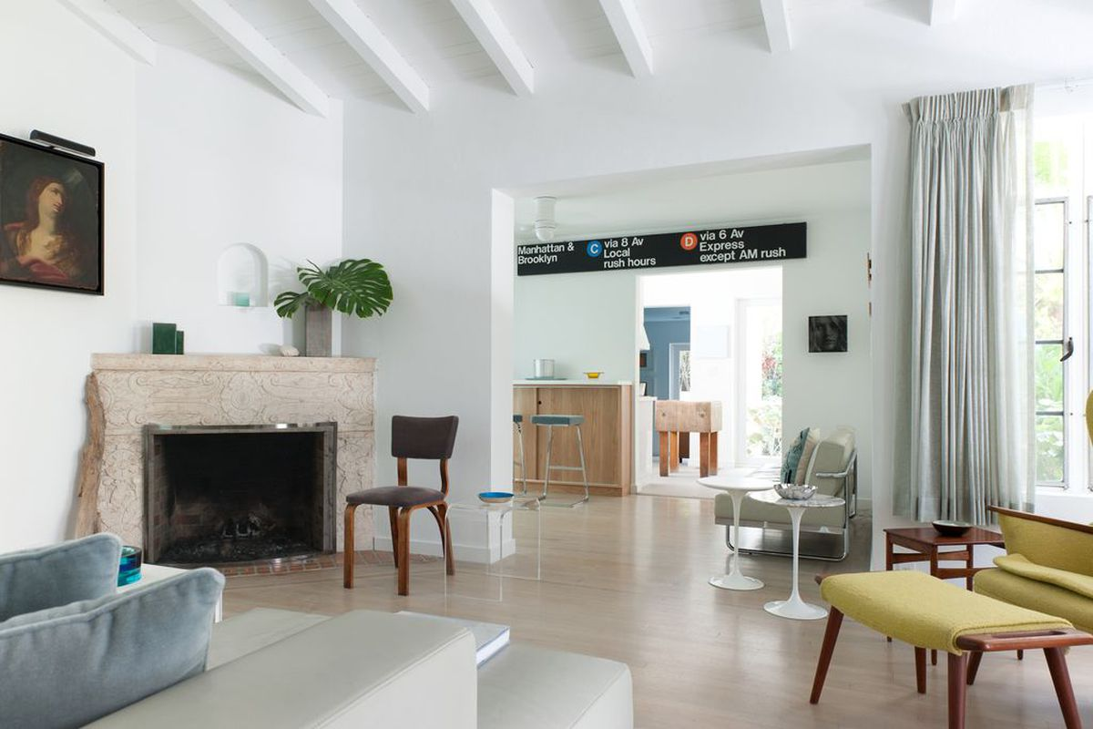 Inside a historic home in Miami with a NYC subway sign in the living room
